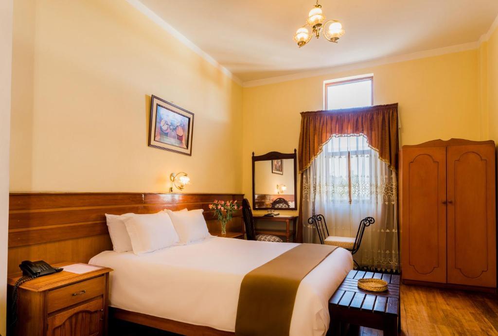 Cama o camas de una habitación en Majestad Hotel Boutique