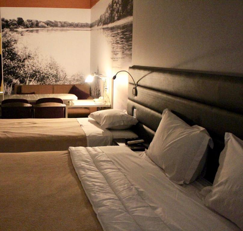 Cama ou camas em um quarto em AGA Nortel