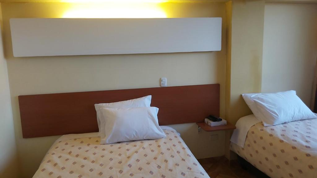 Cama o camas de una habitación en Apu Cusco