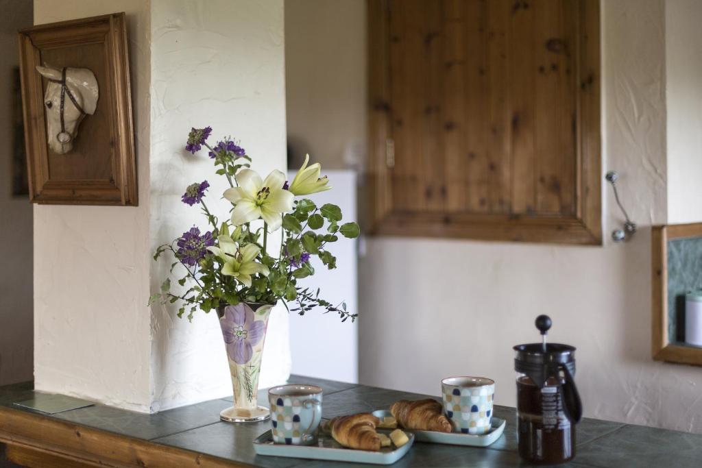 A kitchen or kitchenette at Strangford View Mews