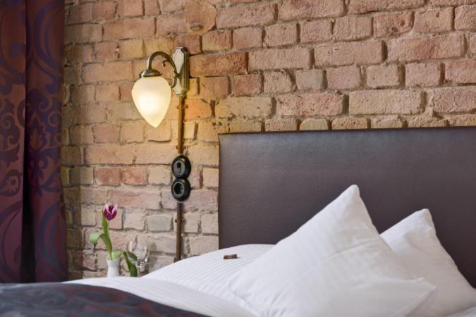 Un ou plusieurs lits dans un hébergement de l'établissement Hotel Sarotti-Höfe