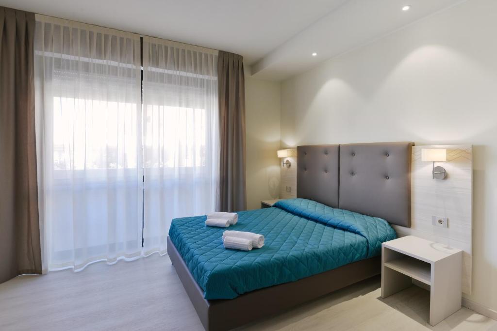 Postelja oz. postelje v sobi nastanitve Residence Picalè