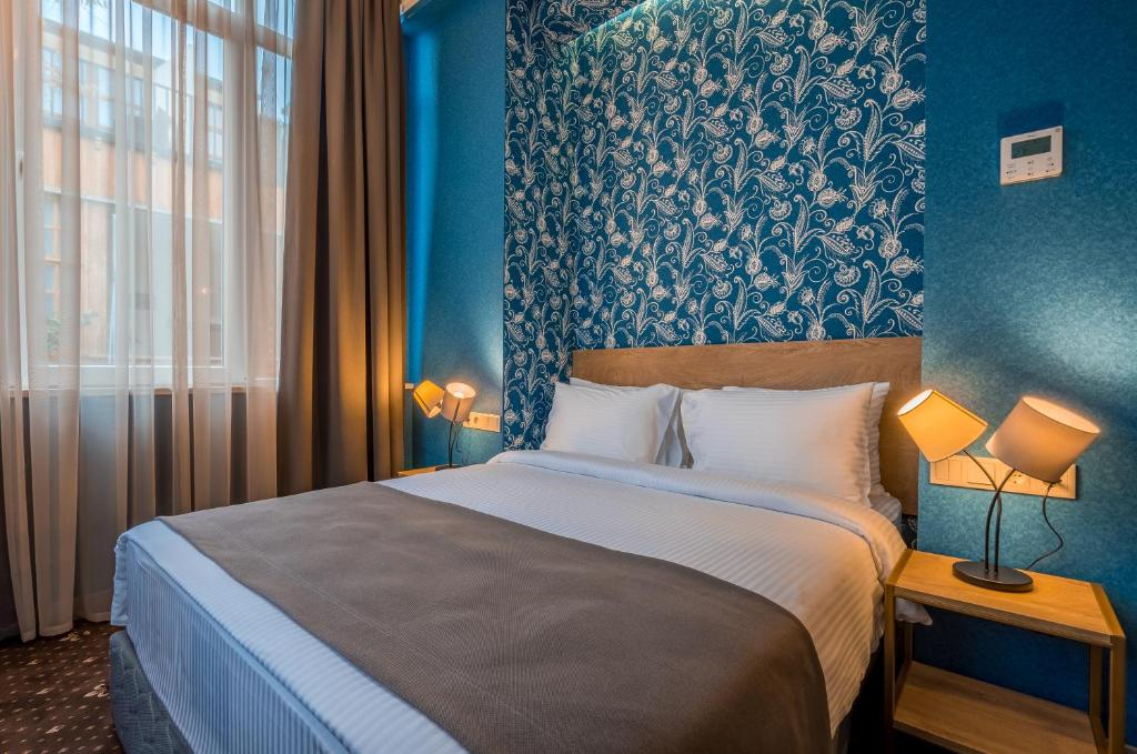A bed or beds in a room at Gladius Inn Boutique Hotel