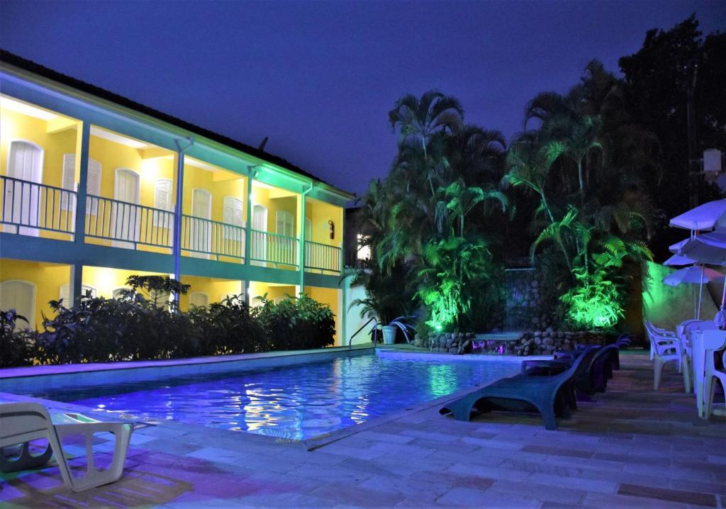 A piscina localizada em Pousada Estrela de Paraty ou nos arredores