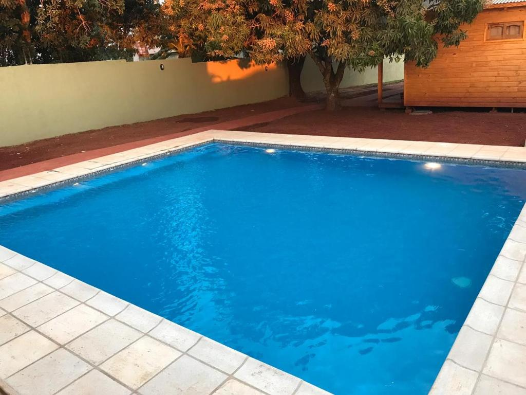 The swimming pool at or near BUGANVILIAS LODGE