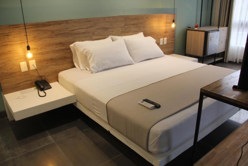Кровать или кровати в номере Hotel G