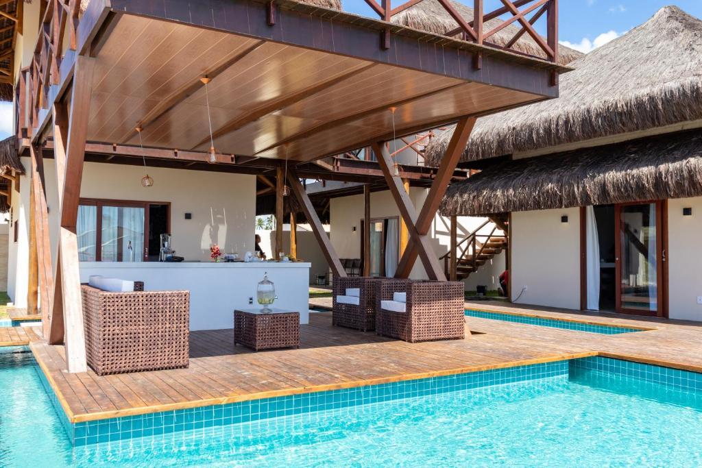 A piscina localizada em Villa Namú Beach House Suites ou nos arredores