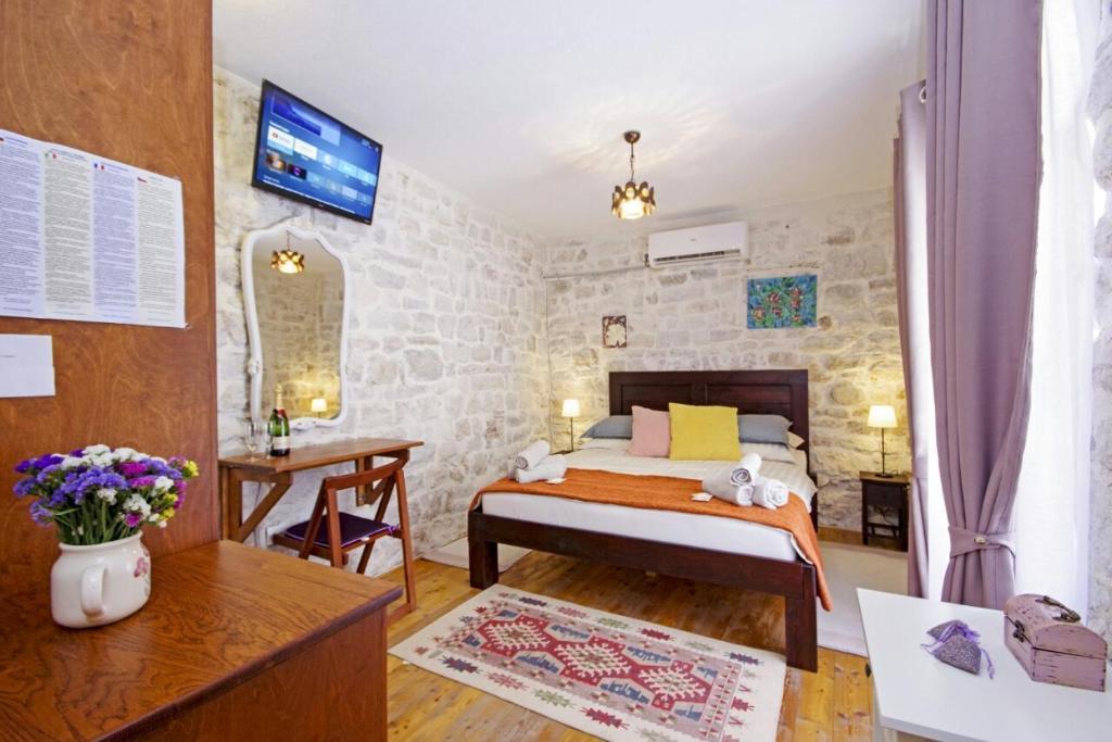 Postel nebo postele na pokoji v ubytování TowerHouseSasso
