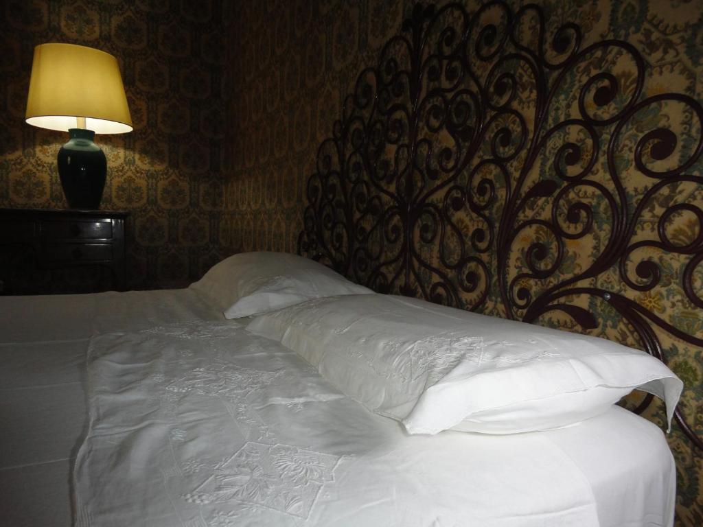 A bed or beds in a room at Le Stanze del Notaio