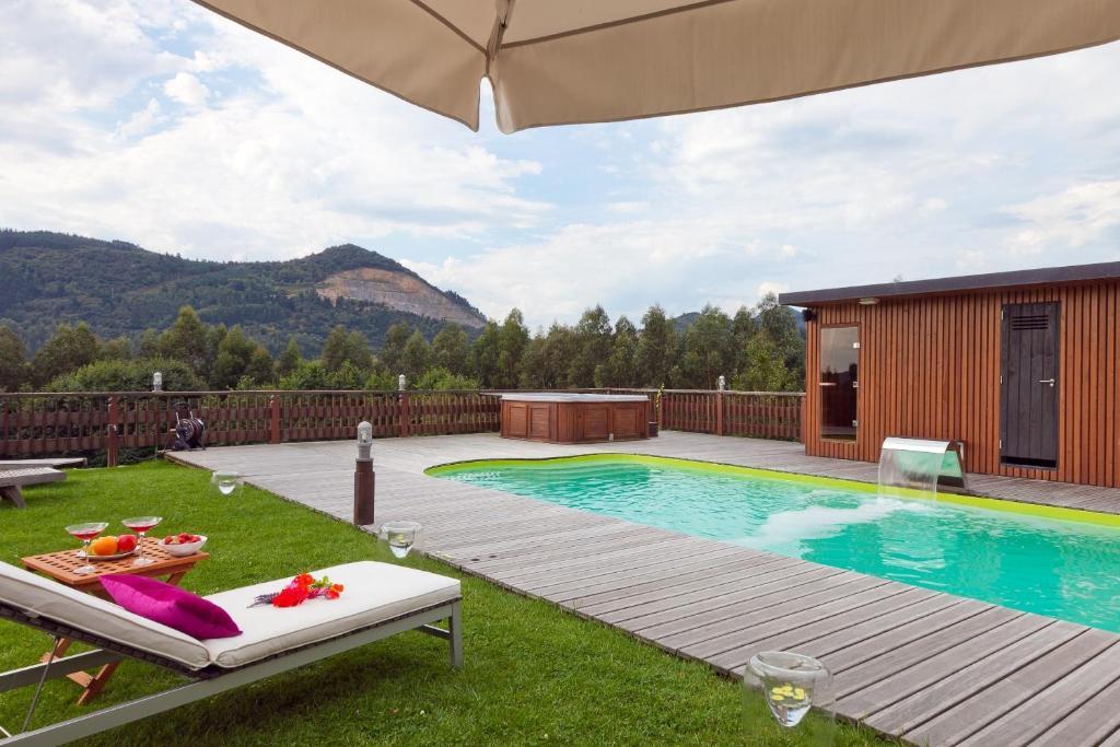 The swimming pool at or near Las Casas De Ea Astei