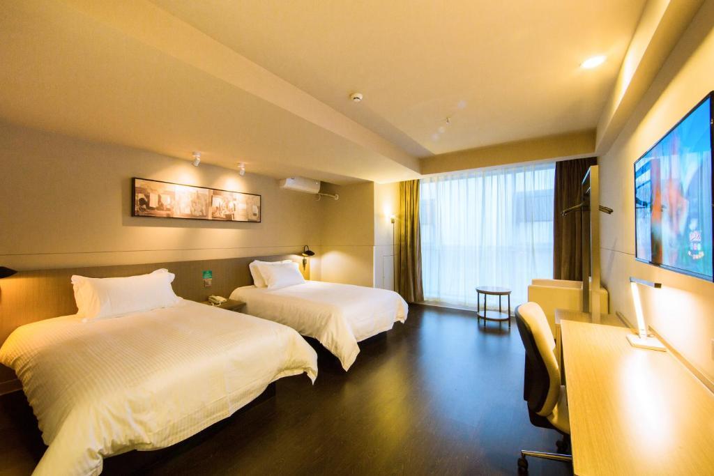 Cama o camas de una habitación en Jinjiang Inn Select Kunming High-speed Railway Station