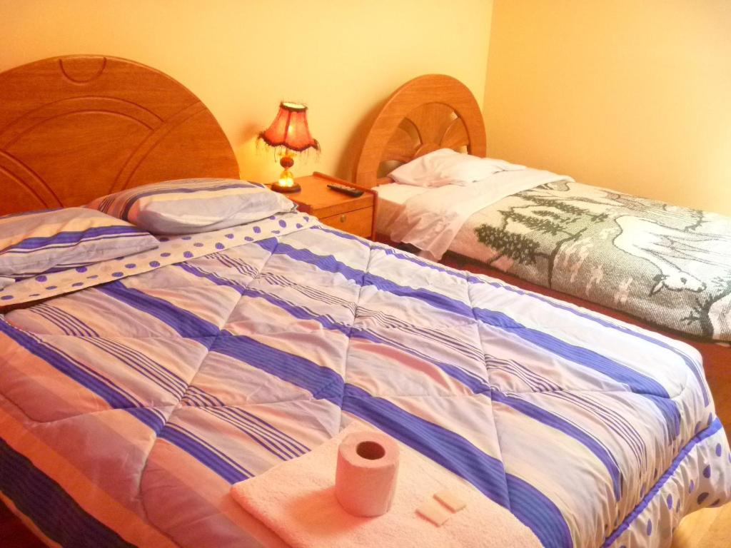 Cama o camas de una habitación en Feel at Home