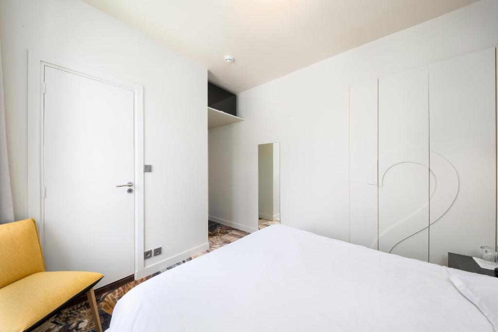 Ein Bett oder Betten in einem Zimmer der Unterkunft Restaurant Hotel Didier Méril