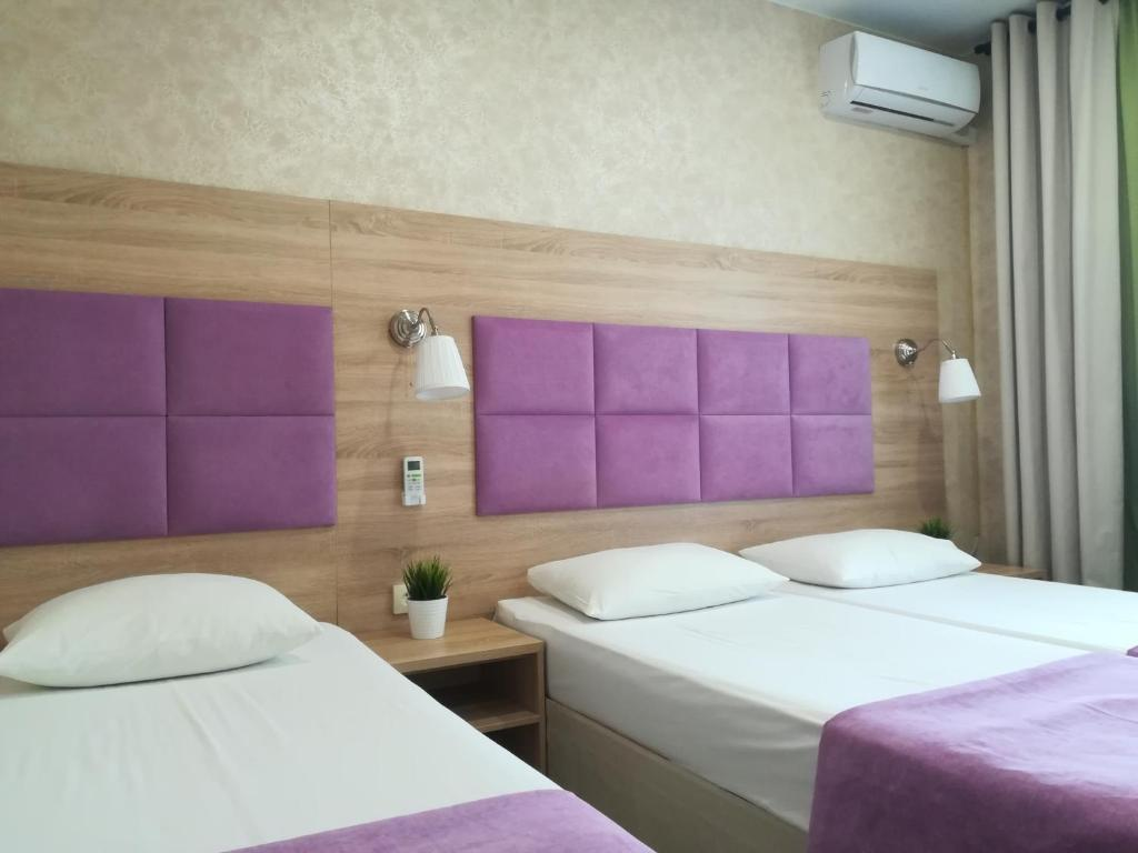 A bed or beds in a room at AMOSOV
