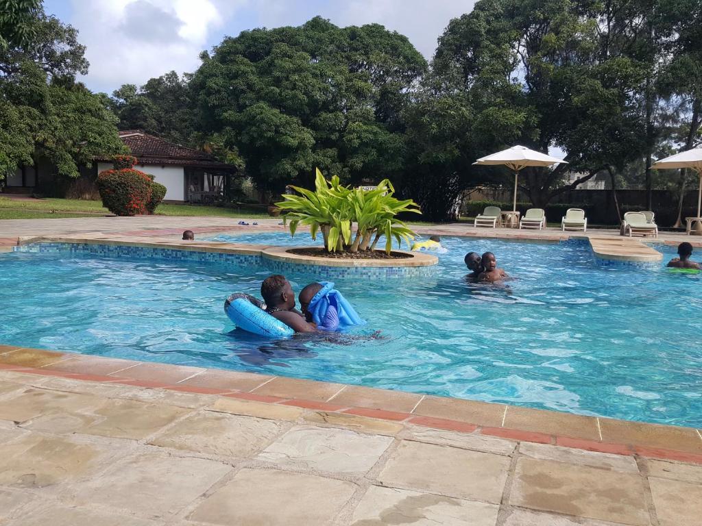 The swimming pool at or near Mwembe Resort & The Village
