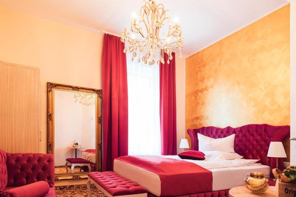 Ein Bett oder Betten in einem Zimmer der Unterkunft Hotel Hamburger Perle