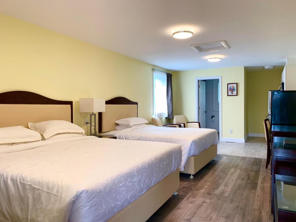 Cama o camas de una habitación en 7 West Motel