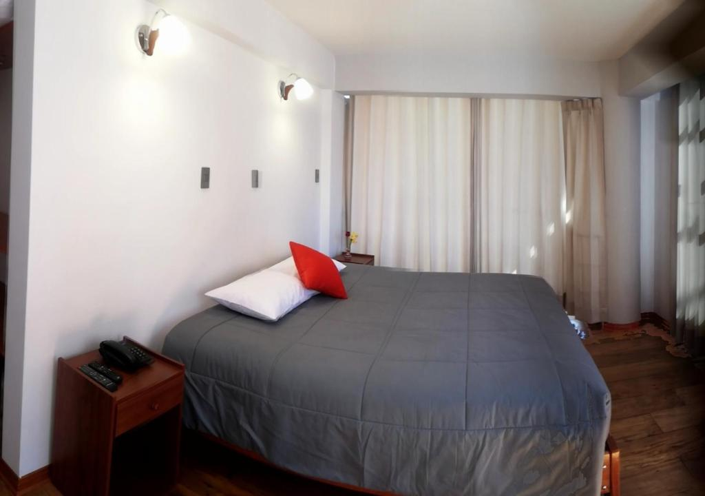 A bed or beds in a room at Real House Cusco