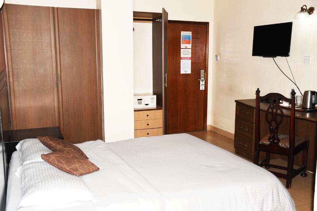 Voodi või voodid majutusasutuse Jamia Central Hotel toas