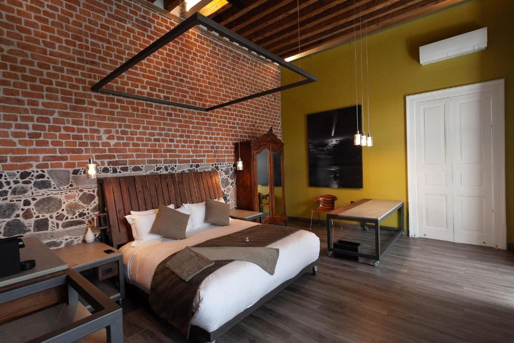 A bed or beds in a room at Mumedi Design Hotel