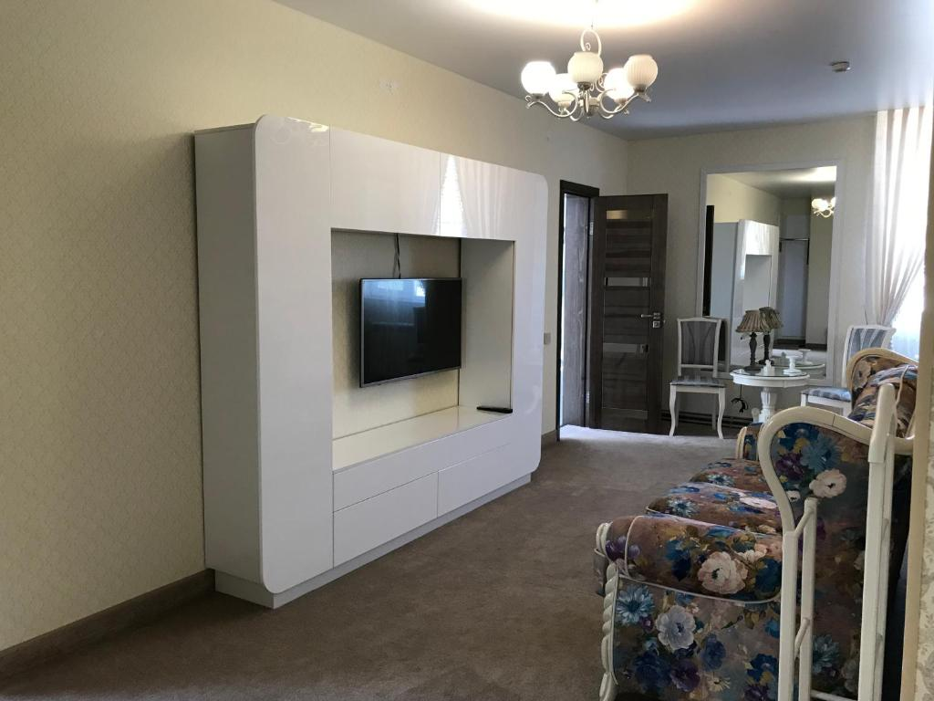 A television and/or entertainment center at Guest House Aviator
