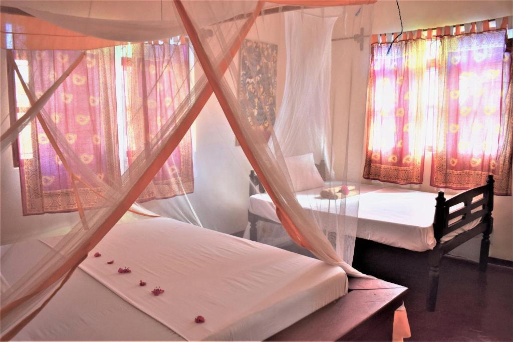 Un pat sau paturi într-o cameră la Zanzibar Dream Lodge