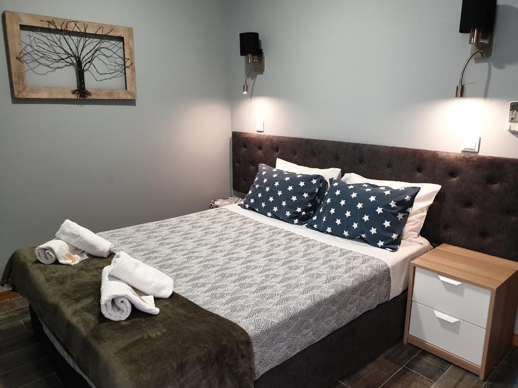 Cama o camas de una habitación en Leao de Ouro