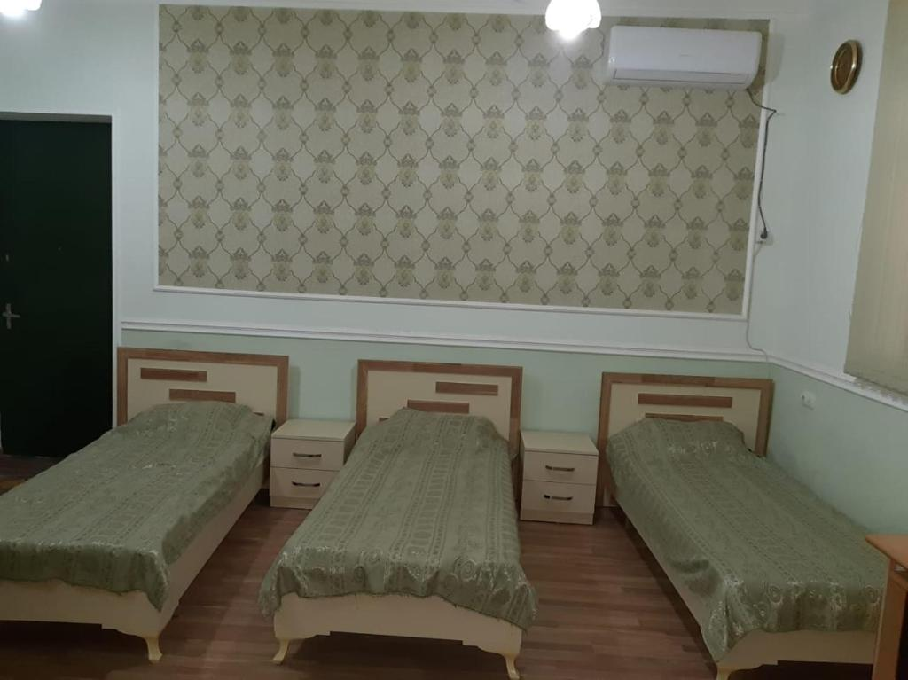 A bed or beds in a room at Hostel