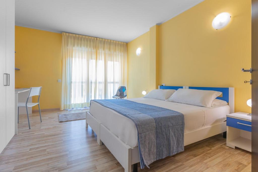 Ein Bett oder Betten in einem Zimmer der Unterkunft Asso Residence
