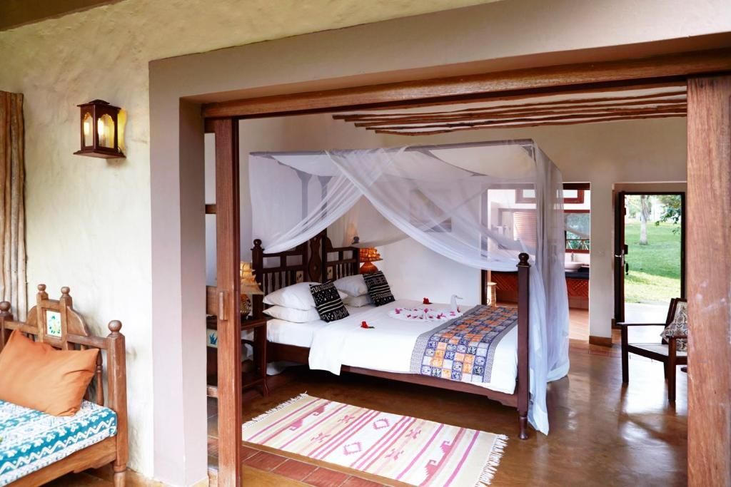 A bed or beds in a room at Neptune Palm Beach Boutique Resort & Spa - All Inclusive