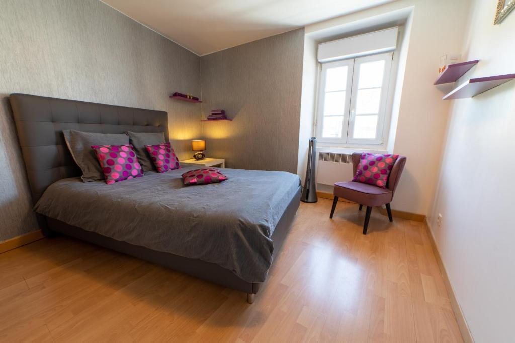 Ein Bett oder Betten in einem Zimmer der Unterkunft Le Félix Grat