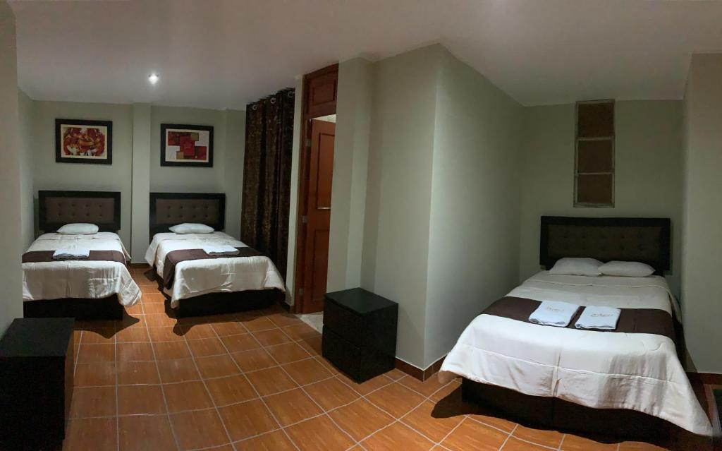A bed or beds in a room at ANTARES Pisco