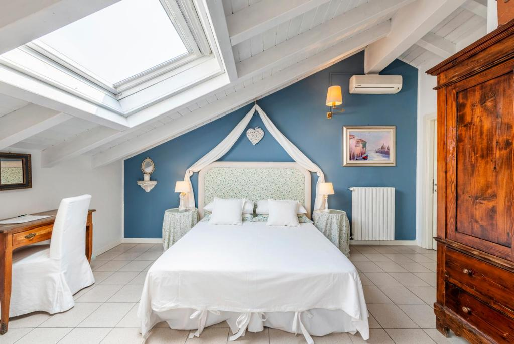 A bed or beds in a room at B&B De I Bravi
