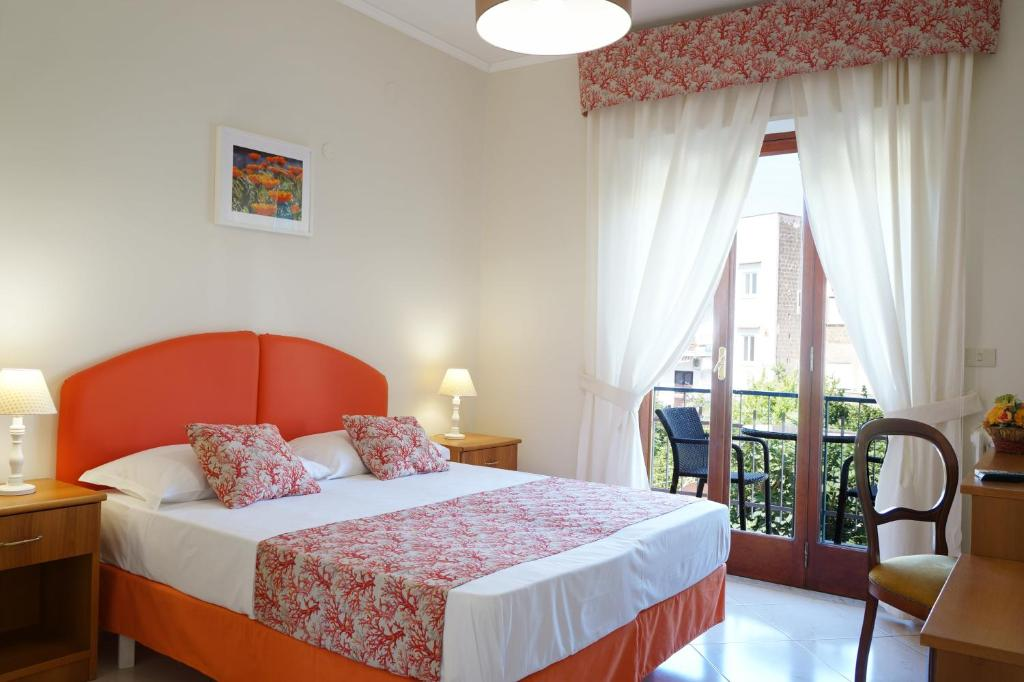 A bed or beds in a room at Villa Susy