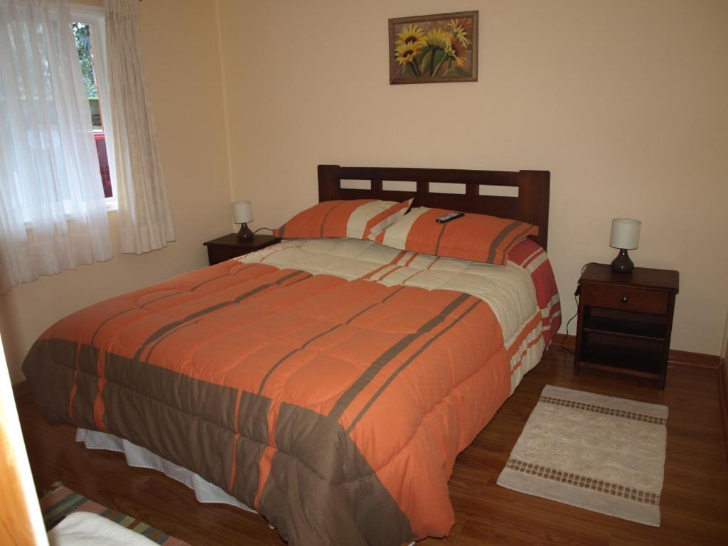 Cama o camas de una habitación en Hostal Plaza Las Banderas