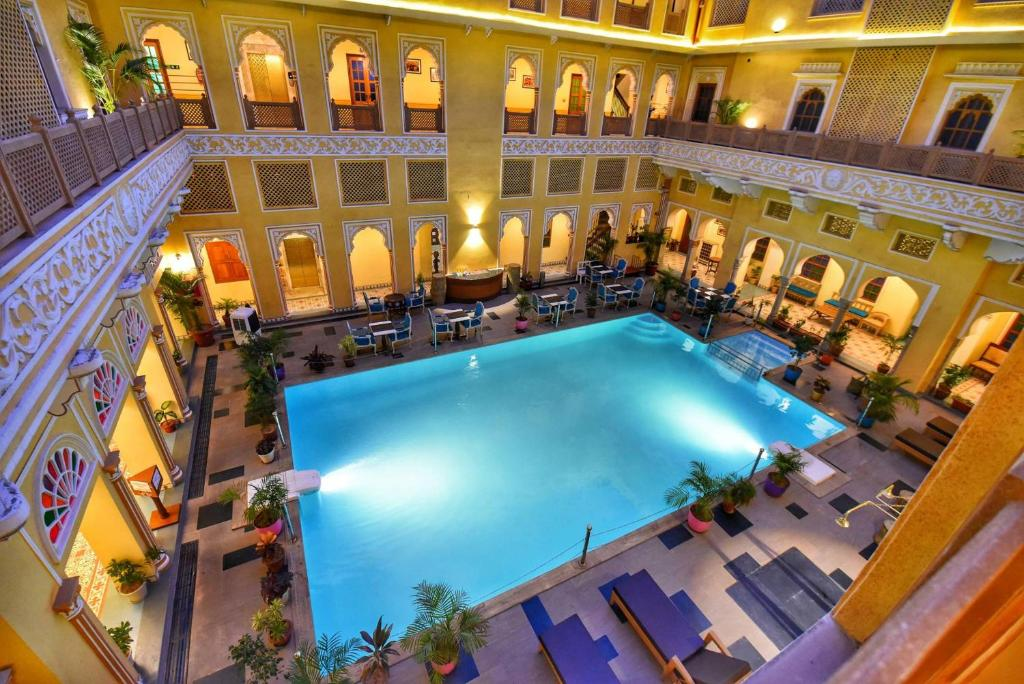 A view of the pool at Nirbana Heritage Hotel and Spa or nearby