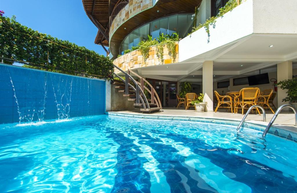 The swimming pool at or near Divi-Divi Praia Hotel