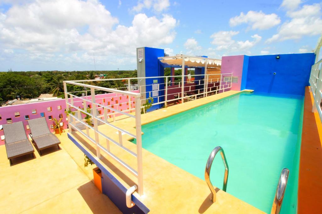 Uitzicht op het zwembad bij Hotel Arco Iris near Bus Station of in de buurt