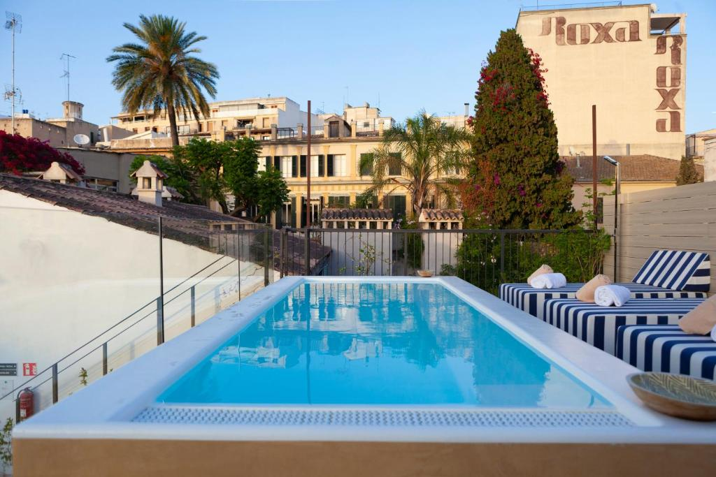 The swimming pool at or near M House Hotel