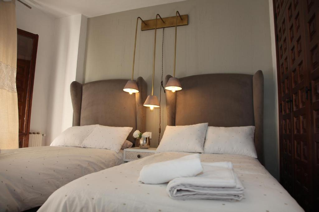A bed or beds in a room at Apartamento San Juan