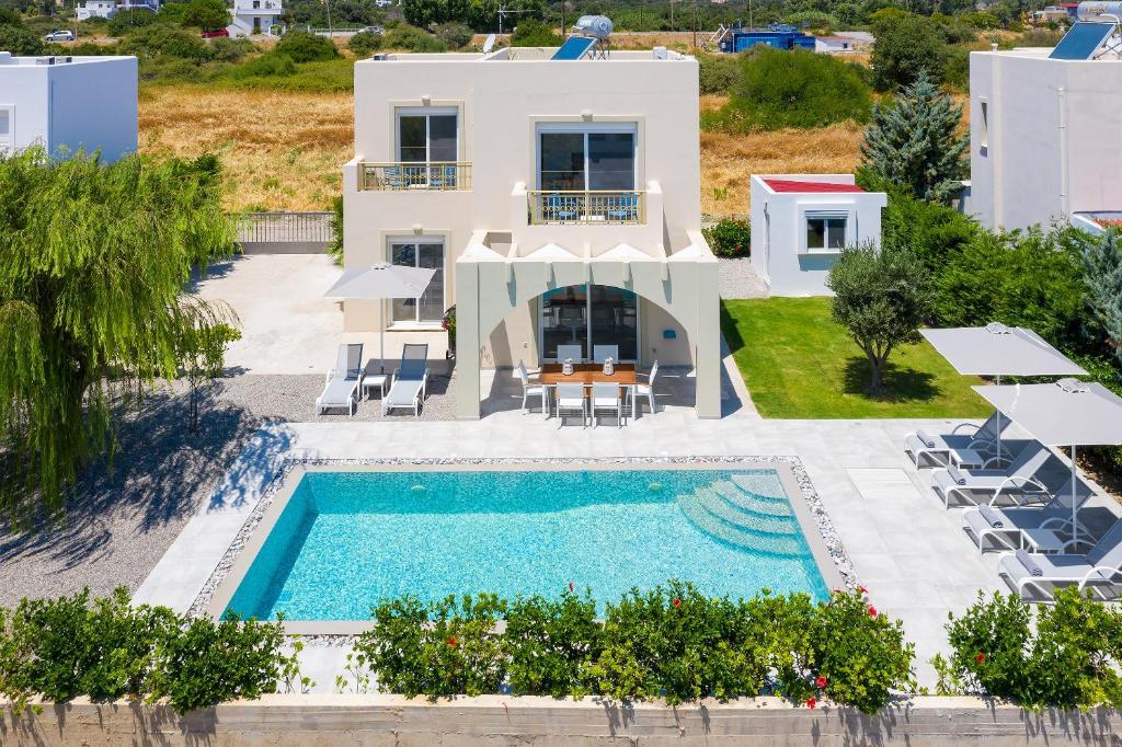 Výhled na bazén z ubytování Olive Tree House nebo okolí