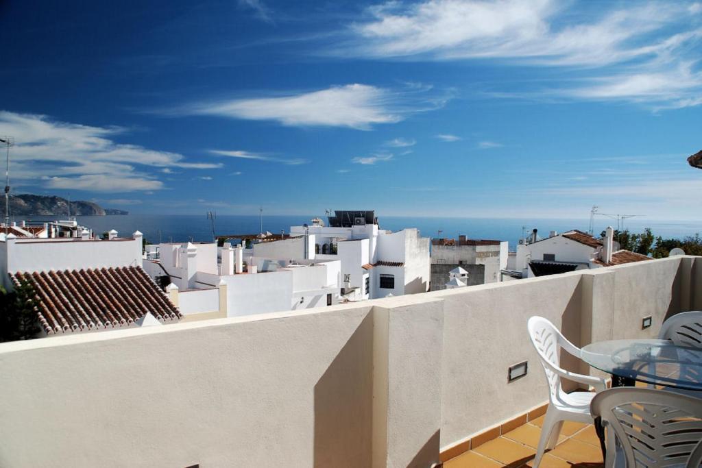 Un balcón o terraza de Apartamentos Plaza