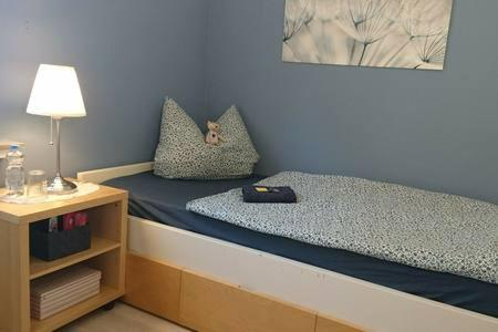 A bed or beds in a room at Bed & Breakfast Bonn