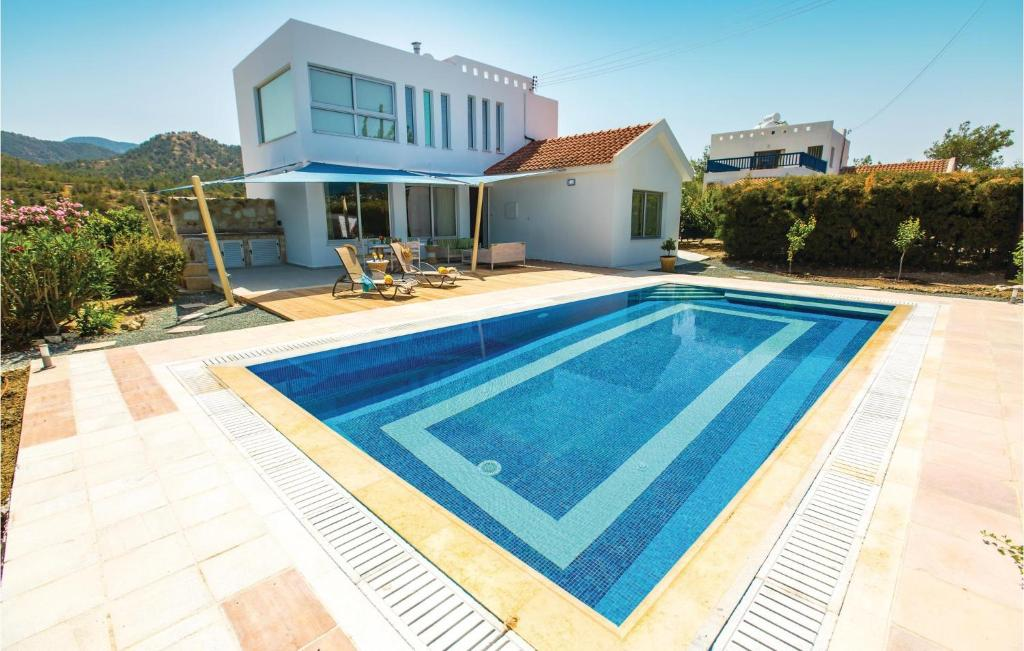 The swimming pool at or near Three-Bedroom Holiday Home in Argaka