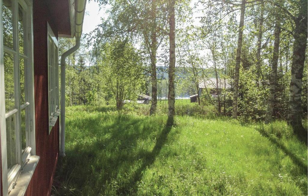 A garden outside Holiday Home Bergsjo with Lake View I