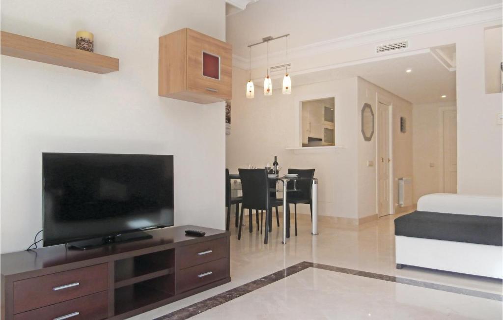 A television and/or entertainment center at Two-Bedroom Holiday home San Javier 0 01