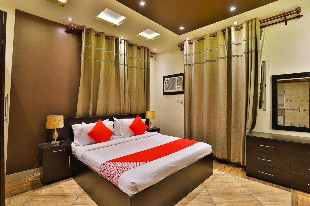 A bed or beds in a room at OYO 289 Matal Al Hadaiq