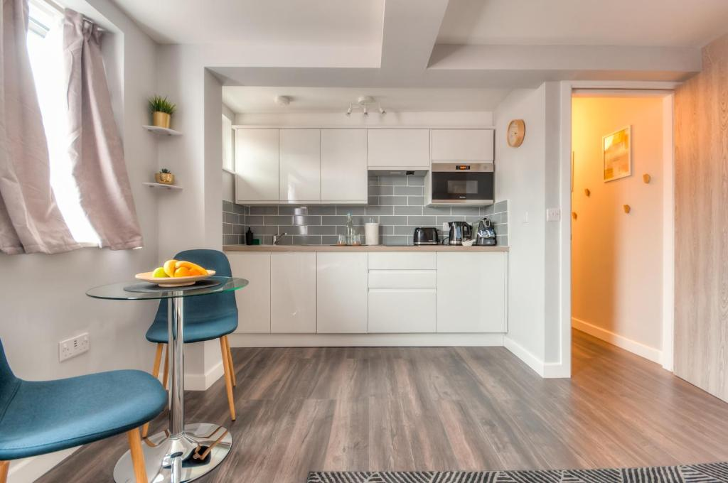 A kitchen or kitchenette at Design Suites Lytham