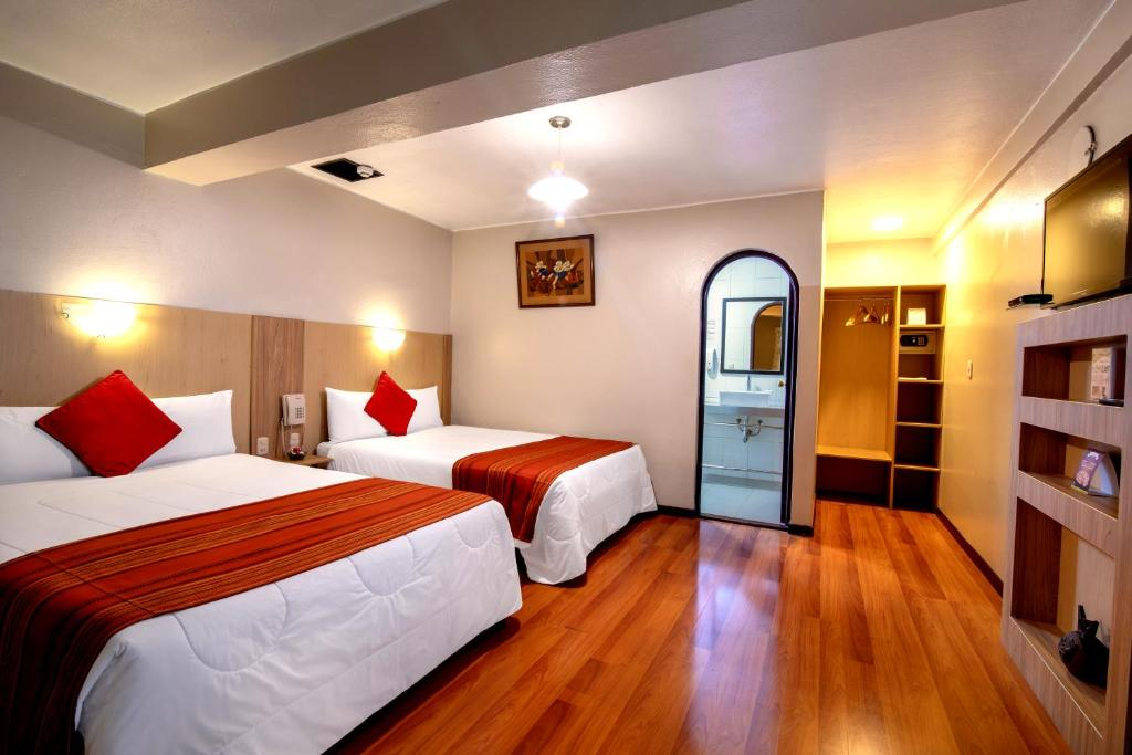 Cama o camas de una habitación en Royal Inka II By Xima Hotels