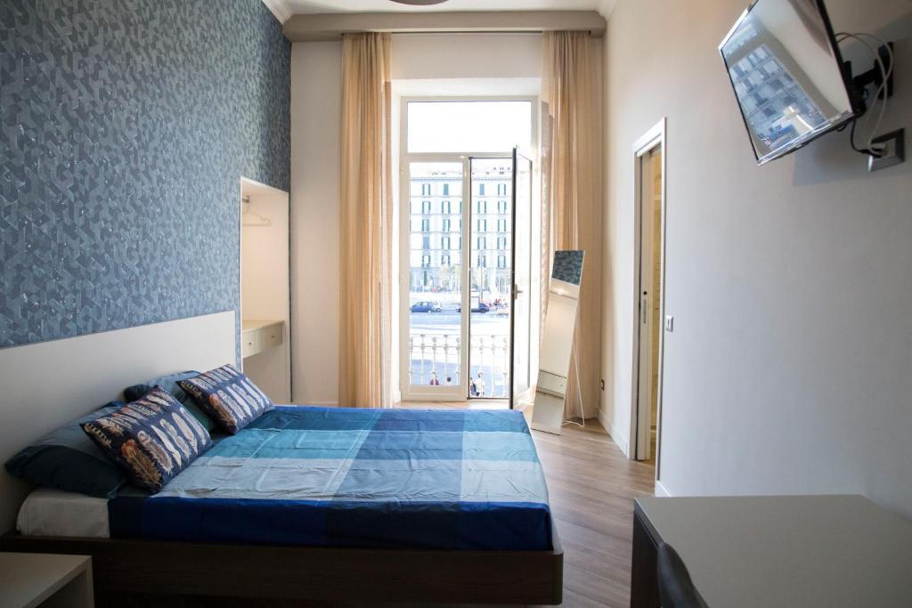 Letto o letti in una camera di Garibaldi Rooms